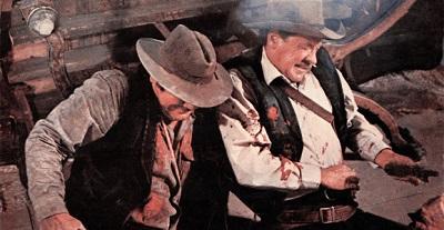 THE WILD BUNCH, from left: Ernest Borgnine, William Holden, 1969